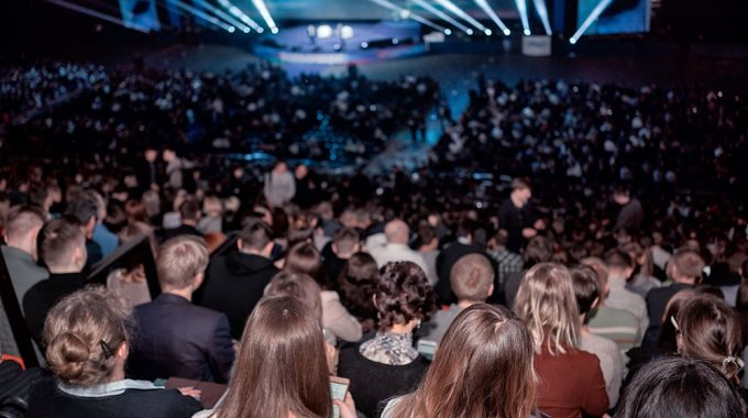Large Audience Symbolizing Event Industry Growth