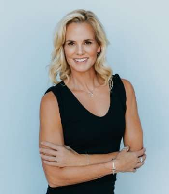 Dara Torres smiling at camera with arms crossed at waist