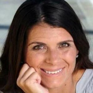 Mia Hamm smiling at camera with hand on chin